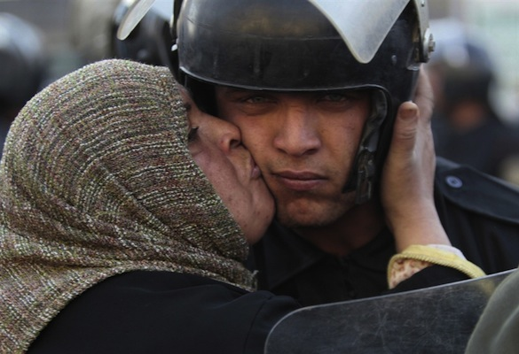 Egyptian protester kisses policeman